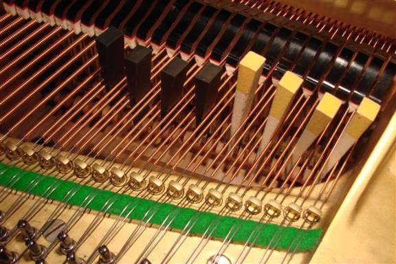 Muting of a series of two string string-sets on a grand piano using multiple mutes